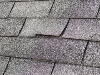 Roof shingles curling and buckling upwards